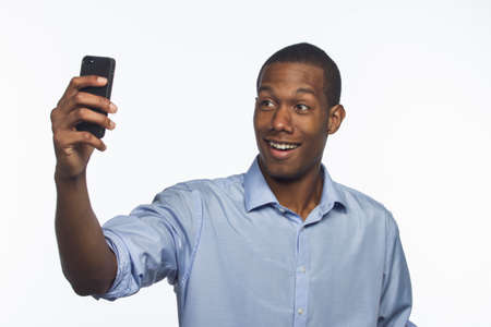 Young African American man taking selfie picture with smartphone, horizontal