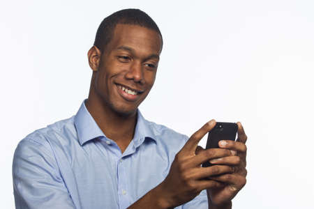 Young African American man taking picture with smartphone photo