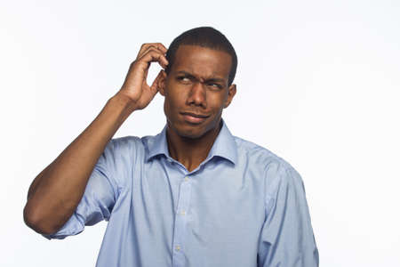 Young African American man scratching head, horizontal photo