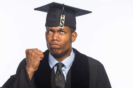 education loan: Recent college graduate angry about tuition price tag, horizontal Stock Photo