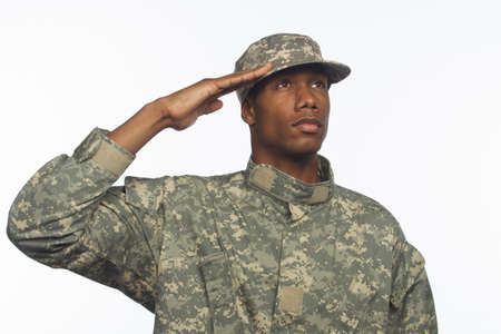 Young black military man saluting horizontal