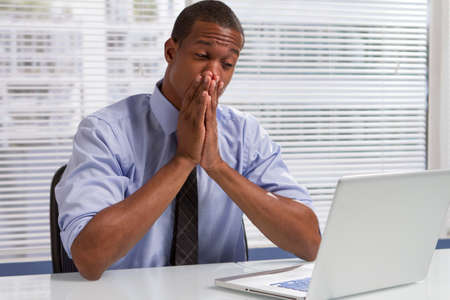 people at work: African American businessman nervous and looking at computer, horizontal Stock Photo