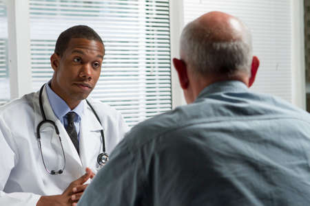 medical doctors: African American doctor consulting with patient, horizontal