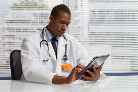 doctor tablet: African American doctor with tablet, horizontal Stock Photo