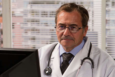 Close up of doctor using his computer, horizontal photo