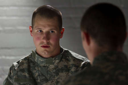 PTSD soldier being consoled by peer, horizontal