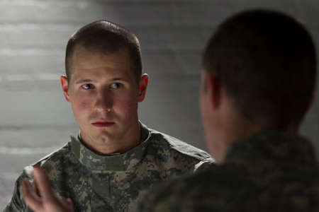 Soldier being consoled by peer, horizontal