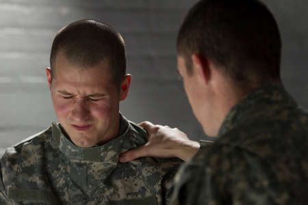 traumatic: Sad military man being consoled by peer, horizontal
