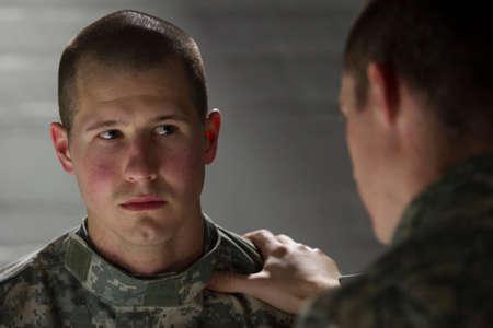 Soldier consoling his sad peer, horizontal