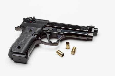 Handgun with bullets, horizontal Stock Photo