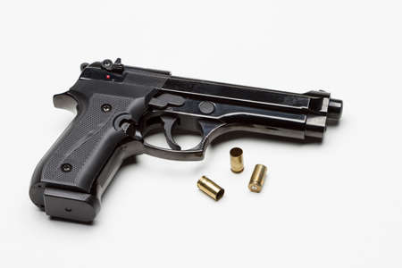 Handgun with bullets, horizontal Stock Photo