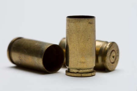Three bullet shells against white background, horizontal Stock Photo