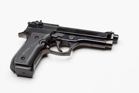 Handgun against white background, horizontal Stock Photo