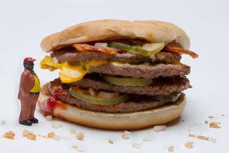 Man looking at hamburger, horizontal