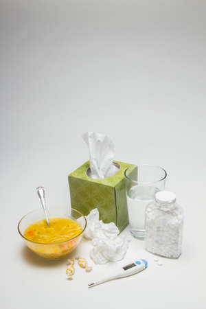 Cold and flu remedies and necessities, vertical Stock Photo