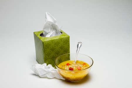 cold remedy: Box of tissue and chicken noodle soup