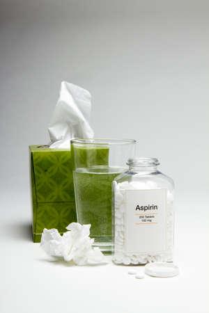 aspirin: Tissue and aspirin with a glass of water, vertical