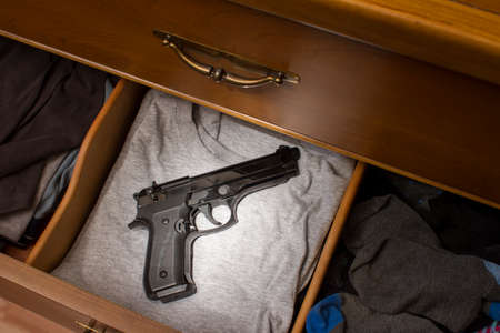 handgun in drawer