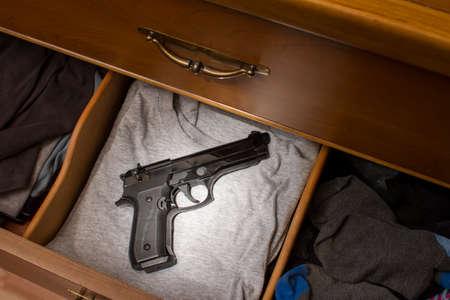 handgun in drawer Stock Photo - 37493314