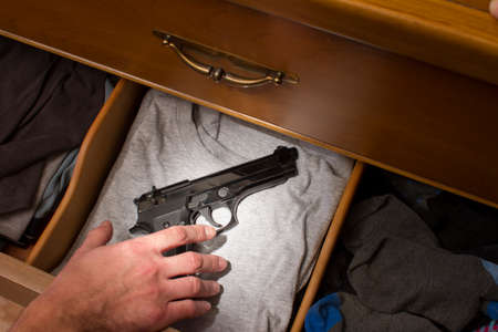 drawers: handgun in drawer