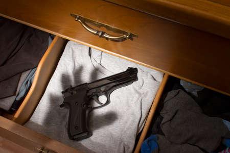 handgun in drawer