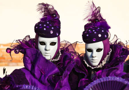two beautiful masks on venice carnival photo