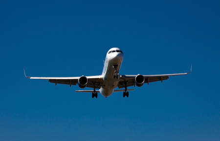 photograph of an airplane few seconds before landing  photo