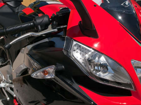 detail of front side of red motorbike