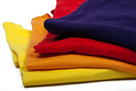 several colored t-hirts on white background Imagens