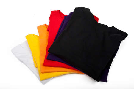 many colored: a stack of t-shirts isolated on white background