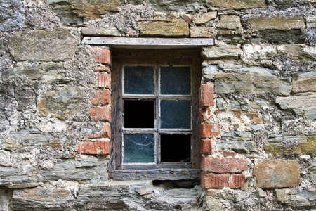 old wooden window frame with broken glass