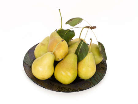 fresh pears on plate with foliage photo
