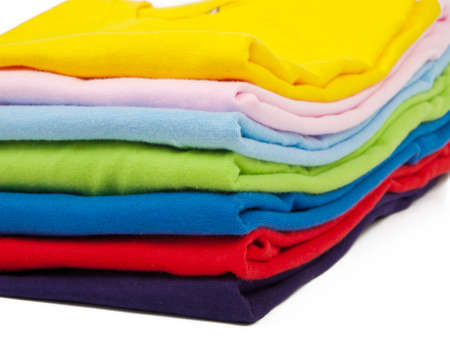 many colored: a stack of colorful t shirts - front view