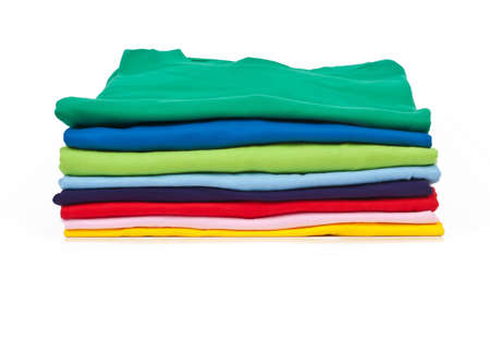 a stack of colorful t shirts, shot in studio
