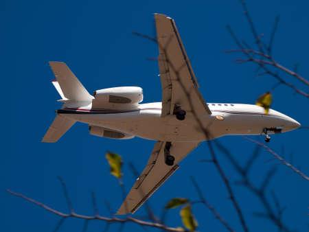 detail of airplane landing... on sunny day Stock Photo