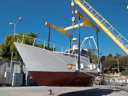 sportfishing: fishing boat after repair on crane