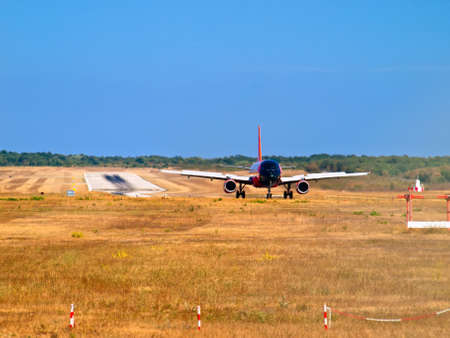 airplane on runway - front view  photo