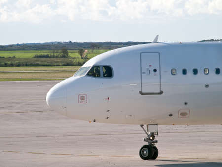 passenger aircraft on airport preparing for takeoff Stock Photo