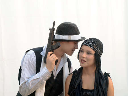bonnie: young couple with machine gun dressed in retro style