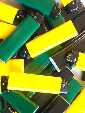 a pile of colorful lighters photo