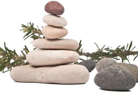 dark rocks, balanced rocks and branch of rosemary