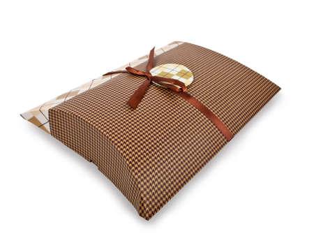 ova: oval gift box with bronze ribbon Stock Photo