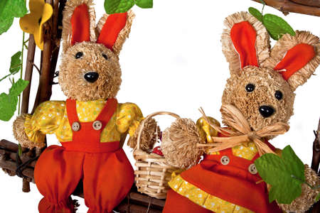 two easter bunnies with basket of eggs photo