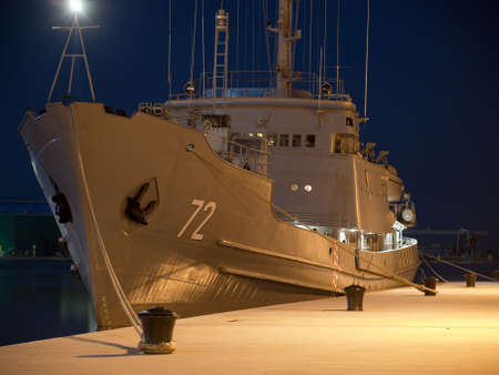 military ship anchored in winter night