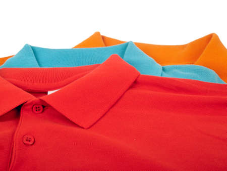 pile of man polo shirts isolated on white background photo