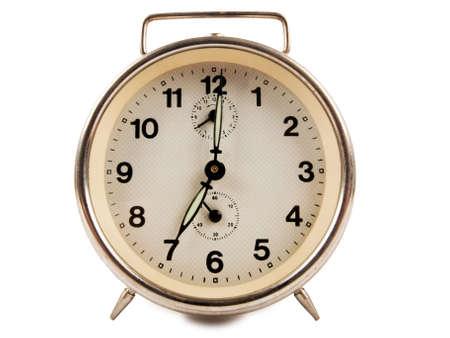 reveille: old alarm clock isolated on white background Stock Photo