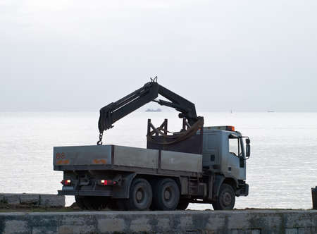 Ship on sea trial in cloudy afternoon - the truck is going back