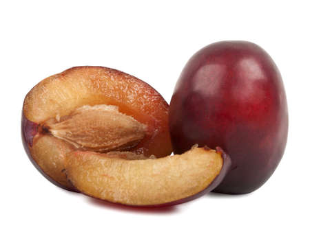 some delicious fresh plums over white background photo