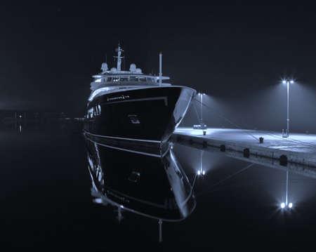 prow: modern yacht in autumn night Stock Photo