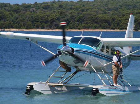 PULA, CROATIA - JULY 1, 2013   Sea plane landing on sea surface connecting two cities and countries  Giulianova, Italy and Pula, Croatia